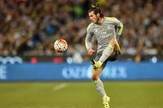 Gareth Bale, the welsh dragon, takes down the ball with skill.