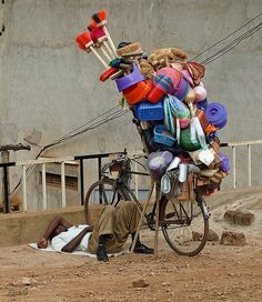 Ugandan salesman carting all his wares by bicycle ----- by Exxelle, via Flickr
