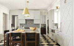 Gold hardware paired with a black and white checkerboard flooring and a graphic backsplash.  Unique and lovely.