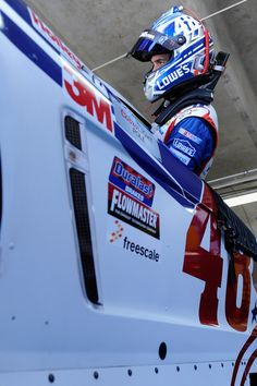 Jimmie Johnson Photos Photos - Jimmie Johnson, driver of the #48 Lowe's Patriotic Chevrolet, climbs into his car during practice for the NASCAR Sprint Cup Series Coca-Cola 600 at Charlotte Motor Speedway on May 23, 2015 in Charlotte, North Carolina. - Charlotte Motor Speedway - Day 2
