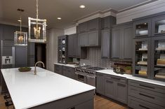 Kitchen by Romanelli & Hughes Custom Home Builders in Chevron And Herringbone Patterns - Add Exciting Zigzags To Your Kitchen!
