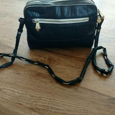 """Anthropologie Pour La Victoire Leather Cross Body In GUC. Soft black leather with white trim. Dimensions are approx 8"""" X 10""""  X 8"""". Unique strap with partially exposed metal through out which gives it the industrial look. Has been worn, but still in great condition. Inside very clean! Anthropologie Bags Crossbody Bags"""