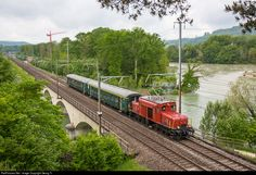 """The short or little """"crocodile"""" De 6/6 # 15301, built in 1925 for the Seetalbahn line Lucerne-Lenzburg-Wildegg of the SBB, with a short charter train on the Reuss bridge near Turgi, with the larger Aare river on the right and a WW II bunker where the two rivers are joining. The locomotive is owned and operated by association """"Seetalkrokodil 15301"""" and based in the Bahnpark Brugg (AG). The two standard cars type A II and B I belong to association """"Mikado 1244"""" in Brugg."""