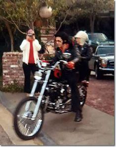 Elvis Presley riding his bike