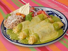 This copycat recipe for the famous chicken enchiladas at El Torito uses cooked chicken and fire-roasted green chile sauce mixed with sour cream. | CDKitchen.com