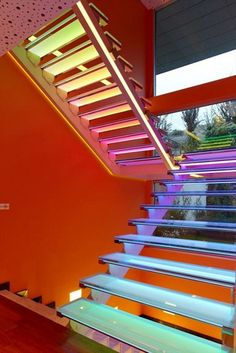 Colorful Staircase At Futuristic Orange House In Ankara, Turkey By Yazgan Design Architecture home trends design photos, home design picture at Home Design and Home Interior Objet Deco Design, Escalier Design, Glass Stairs, Floating Stairs, Stair Lighting, Lighting Ideas, Interior Lighting, Staircase Design, Stair Design