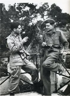 Robert Capa (the well known war photographer) and George Rodger,