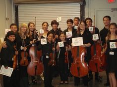 Artist Lara Campiglia donated a piece of art to the Siman Orchestral Foundation children who performed at a fundraiser event