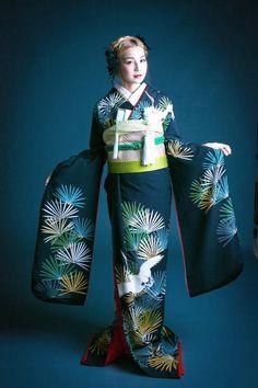 A woman dressed in a furisode kimono.