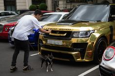Another passer-by, who was walking his dog, takes a close-up of the Hamann Mystere's badge as it joined a collection of flashy vehicles Center Stage, Range Rover, Lamborghini, Super Cars, London, Street, Vehicles, Badge, Walking