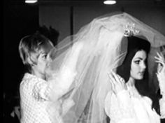 Joan Esposito helping Priscilla with her veil
