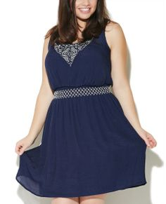"""Fun and fresh boho chic inspired tank dress features a gauze woven body, tribal design embroidered along the scoop neck, and a smocked waist with embroidery detailing. Dress is fully lined.  Model is 5'9"""" and wears a size 1X.      50% Polyester / 50% Rayon      Machine Wash     Imported"""