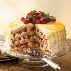 This decadent layered lemon cake starts with a cake mix and is filled with chopped frozen cheesecake and white chocolate and topped with lemon curd.