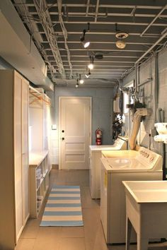 One easy method to create a modern appearance is to include a new light. It's a cost-effective way to start a style or up your laundry room's design. tag: Basement laundry room unfinished, basement laundry room flooring, cinder blocks, concrete floor, spaces, wall color, tips, storage shelves open ceiling, drywall, how to paint.