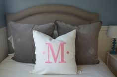 love this huge monogrammed pillow for the bed!