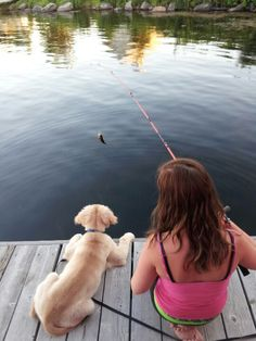 a girl and her dog...just fishin...............