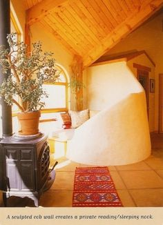 Cozy  curvy cob bench in a strawbale house. by mollyahuff