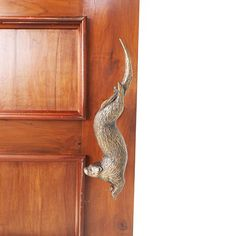 Otter Solid Brass Door Handle / Pull - Displayed on a door Brass Door Handles, Sand Casting, Door Pulls, Front Elevation, Otters, Solid Brass, Antique Brass, Hand Carved, Hardware