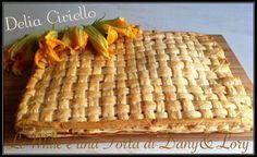 PARIGINA CON FIORI DI ZUCCA RICETTA DI: Delia Ciriello Ingredienti per la base: 500 g di farina 1 cucchiaino di sale 1 cucchiaino raso di zucchero