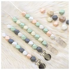 Very nice nude colors for boys and girls, silicone pacifier clip and teething toy