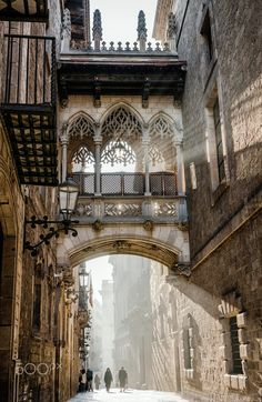 Bisbe street with the famous bridge at the Gothic Quarter in Barcelona