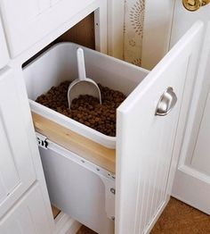 Need inspiration on where to store your pet food? With needing to access it multiple times per day it should be easily accessible but often isn't. Instead of garbage or recycling, this custom cabinet from Better Homes & Gardens holds bulk dog food. Huge open bags aren't stuffed in a corner, or fall over spreading kibble all over the kitchen.