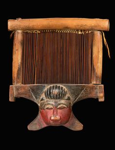 Africa | Heddle loom (loom beater) from the Baule people of the Ivory Coast | Wood and pigment | H. 18.5 cm