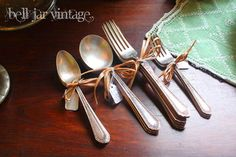 love the old silverware tied with ribbon, baling twine, etc...