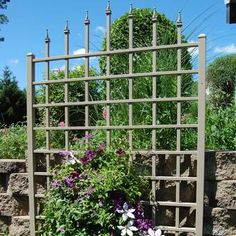 Turn your yard into a palace garden with the Dura-Trel Winchester Vinyl Wall Trellis - Mocha , a large trellis topped with decorative finials resembling. Obelisk Trellis, Wall Trellis, Arbors Trellis, Privacy Trellis, Vine Trellis, Trellis Ideas, Privacy Screens, Garden Arbor, Garden Trellis