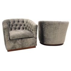 Milo Baughhman silver silk velvet button tufted lounge chairs.  USA  1960's  A pair of curved, button tufted, silver silk velvet lounge chairs with a plinth base finished in a beautiful sap grain rosewood.