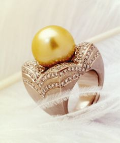 Pearl Ring with Diamonds by Christoph Krähenmann. - Yellow and white gold, a natural green and gold South Sea pearl and diamonds. Photo: Petra love dance
