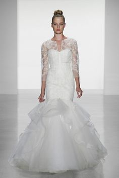 Lace and tulle flare gown with French lace bodice and lace applique layered skirt. Available in Ivory.
