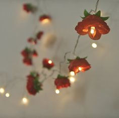A jolly string of 20 Christmas Red Rambling Roses with warm white lights