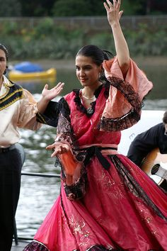 Lyubitshka doing a Romani dance. When I traveled to Russia, there were many Romani who wore such beautiful, colorful costumes in real life about the markets and towns. They are the inspiration for the way I depicted her clan in this story.