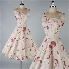 vestido vintage de los años 50. remolinos