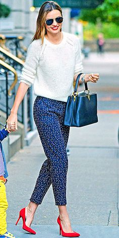 MIRANDA KERR Our feelings about Miranda's wardrobe are pretty obvious. Her latest must-replicate-right-now ensemble – a plush sweater, printed silk pants and bright pumps.