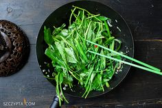 water spinach on wok