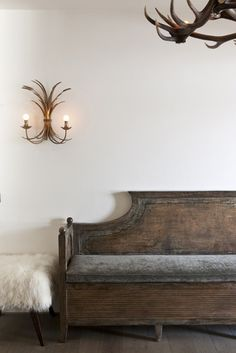 Italy - Veneto   French bench by Terra di Siena,portuguese tool by Mambo and lamps from a french market in the entrance of Baita del Capo,Berica Marchiorello's house in Cortina d'Ampezzo