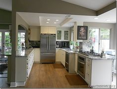 Kitchen after- like the crown molding and canned lights for the use of that space.