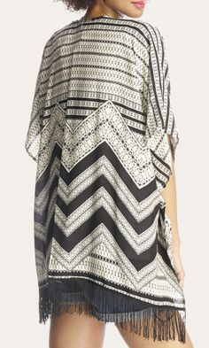 Soft, lightweight black & white Aztec-printed kimono. Perfect festival and easy weekend piece.