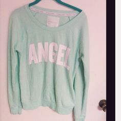 Victoria's Secret Pull Over Mint green Victoria secret sweatshirt. This has been worn so it has some black markings on the top back (in the third picture) but the front is in nice condition. Super warm and cozy. Victoria's Secret Tops Sweatshirts & Hoodies