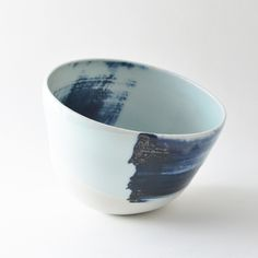 "Porcelain bowl, approx 5.5"" wide, 4"" high.wheel thrown, then hand-altered. glazed glassy white inside, and unglazed outside, with black abstract calligraphic marks.food/dishwasher/microwave safe.all items in this store are made in the wabi sabi tradition. irregular textures and surfaces are part of the work."