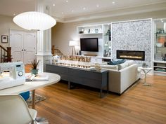 Awesome and Modern Fireplaces by Candice Olson..Love the tiled fireplace wall and the horizontal modren fireplace.