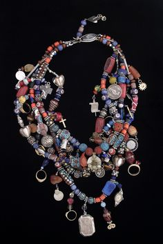 This is what's known as a TREASURE necklace. Mary Ellen sells her work  through galleries, retailers and wholesalers and  she also writes a very interesting blog; Mary Ellen Beads.