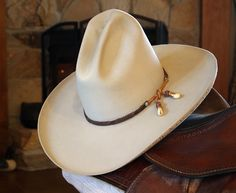 Tall Stetson cowboy hat. The guy I bought this from said it was a display in the Goode Co. BBQ store in Houston and he bought when they closed the store. On the underside of the brim are the brands of Texas ranches that are burned into the hat.