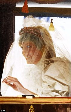 Radiant: An excited Diana travels from Clarence House to St Paul's in the royal carriage, the Spencer tiara keeping her veil in place