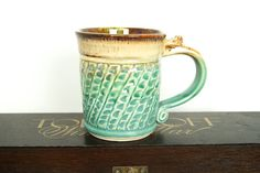 Coffee Mug, Tea Cup, Handmade Pottery, Vibrant Cerulean Green and Frosty Brown  MADE TO ORDER. Custom orders can take as little as 3 weeks and up to 8 weeks for completion. This is not just another cup in the cabinet. This one is something special! A beautiful mug for enjoying your favorite drink of choice. This handmade mug features a wheel thrown and altered profile. Hand carved texture is accented with a satiny smooth cerulean green glaze on the body and a frosty and chocolaty brown on…