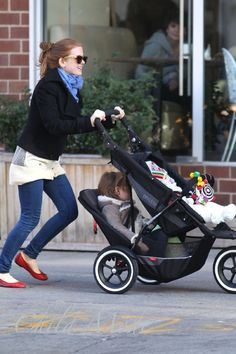 I HATE these strollers!!!!!!!!!!!! why dont you just get a trolly and push your kids around on that. I wonder if it affects the mental development of the kid underneath.