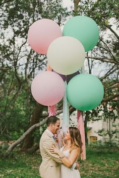 Giant 3ft balloons in baby pink, ivory, and mint green.