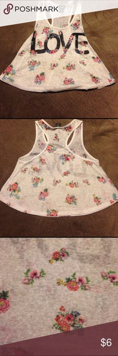 Cute short floral tank top LOVE Rue 21 tank top floral with love across the front. Size smaller from a smoke free home with fur baby 🐶 Rue 21 Tops Tank Tops